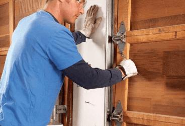 Photo of garage door maintenance performed by Crawford & Brinkman Door & Window Co.