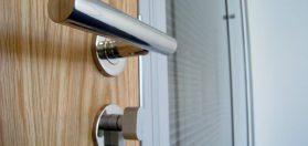 Close-up photo of a door handle and other door hardware.