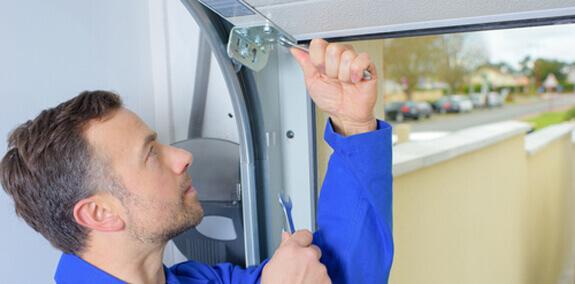 Close-up photo of residential garage door repair.
