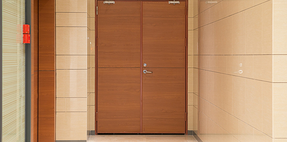 Interior photo of commercial wood entry doors in a school.