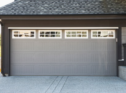 A new gray garage door after Garage Door Installation in Peoria IL