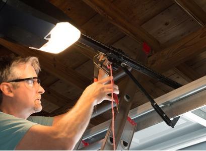 A technician performing Garage Door Repair in Peoria IL