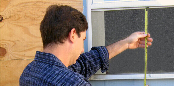 Man Measuring Window for Awnings