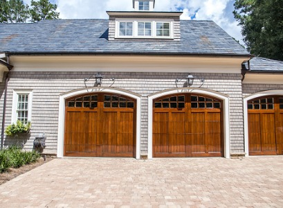 New wooden garage doors after Garage Door Replacement in Peoria IL
