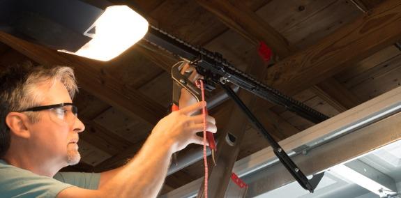 A technician performing Garage Door Repair in East Peoria IL